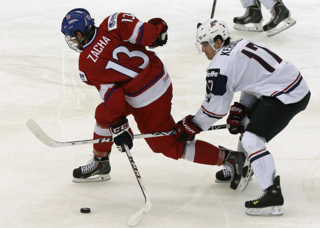 Nicolas Kerdiles of the U.S. checks Czech Republic's Pavel Zacha (L) during the third period of their IIHF World Junior Championship ice hockey game in Malmo, December 26, 2013. REUTERS/Alexander Demianchuk (SWEDEN - Tags: SPORT ICE HOCKEY)