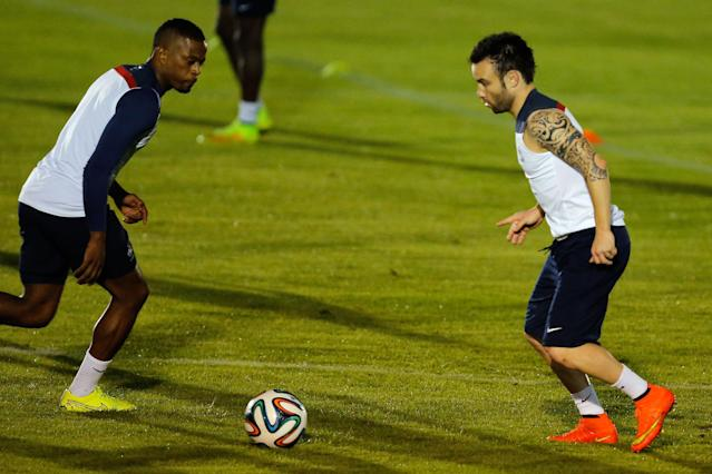 France's Patrice Evra, left, and Mathieu Valbuena run on the field during an official training session at the Joao Havelange Olympic stadium, in Rio de Janeiro, Brazil, Tuesday, June 24, 2014. France will play its next game against Ecuador in group E of the 2014 soccer World Cup. A draw is enough to guarantee top spot for France, and would also send Ecuador through to the next round if Switzerland fails to beat Honduras in the other match. (AP Photo/David Vincent)