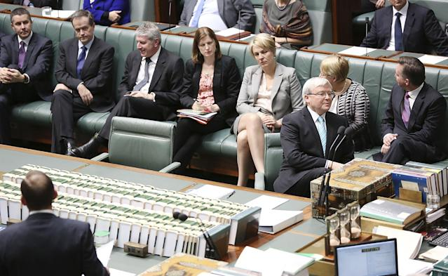 CANBERRA, AUSTRALIA - JUNE 27: Australian Prime Minister Kevin Rudd sits in his new seat flanked by some of his new Ministry in the House of Representatives on June 27, 2013 in Canberra, Australia. Kevin Rudd won an Australian Labor Party leadership ballot 57-45 last night, and will be sworn in this morning as Australian Prime Minister by Governor-General Quentin Bryce. Rudd was Prime Minister from 2007 to 2010 before he was dumped by his party for his deputy Julia Gillard. Gillard has announced that she will leave parliament and not contest her seat following her ballot loss. (Photo by Stefan Postles/Getty Images)
