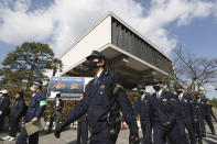 """Police officers patrol near the venue of a ceremony to mark Shimane Prefecture-designated """"Takeshima Day"""" in Matsue, Shimane prefecture, western Japan, Monday, Feb. 22, 2021. Japan renewed its claim on a contested island in the Sea of Japan held by South Korea at an annual event Monday, escalating tensions between the neighbors were already strained over Seoul's compensation claim over Tokyo's World War II atrocities. (Kyodo News via AP)"""
