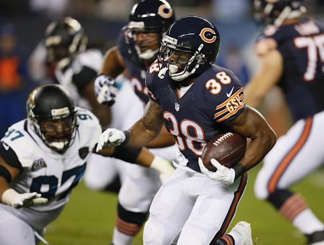 Chicago Bears running back Shaun Draughn (38) rushes against the Jacksonville Jaguars during the first half of an NFL preseason football game in Chicago, Thursday, Aug. 14, 2014. (AP Photo/Andrew Nelles)