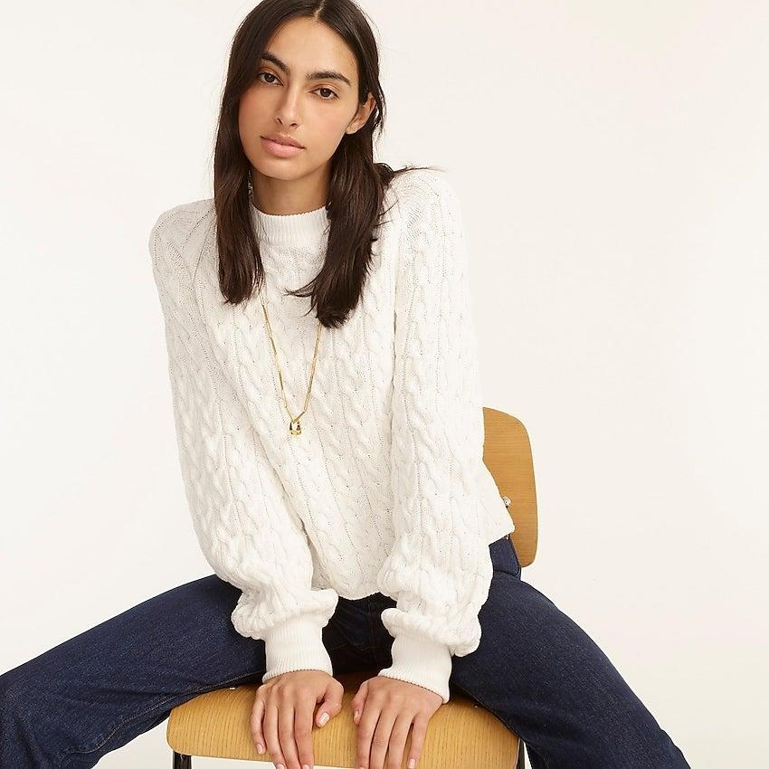 """<br><br><strong>J. Crew</strong> Relaxed-fit cable-knit crewneck sweater, $, available at <a href=""""https://go.skimresources.com/?id=30283X879131&url=https%3A%2F%2Fwww.jcrew.com%2Fp%2Fwomens%2Fcategories%2Fclothing%2Fsweaters%2Fpullovers%2Frelaxed-fit-cable-knit-crewneck-sweater%2FAY824%3Fdisplay%3Dsale%26fit%3DClassic%26isFromSale%3Dtrue%26color_name%3Dwhite%26colorProductCode%3DAY824"""" rel=""""nofollow noopener"""" target=""""_blank"""" data-ylk=""""slk:J. Crew"""" class=""""link rapid-noclick-resp"""">J. Crew</a>"""