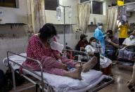 Patient suffering from the coronavirus disease (COVID-19) receives treatment inside the casualty ward at a hospital in New Delhi