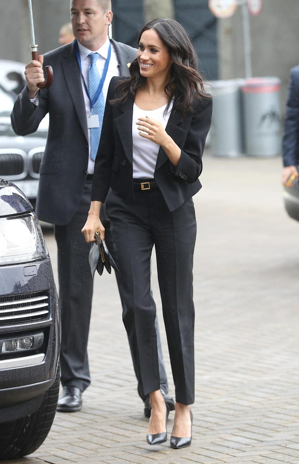 <p>For a visit to Croke Park sporting grounds, Meghan changed into her second outfit of the day, a bespoke Givenchy trouser suit which she paired with Sarah flint heels. <em>[Photo: Getty]</em> </p>