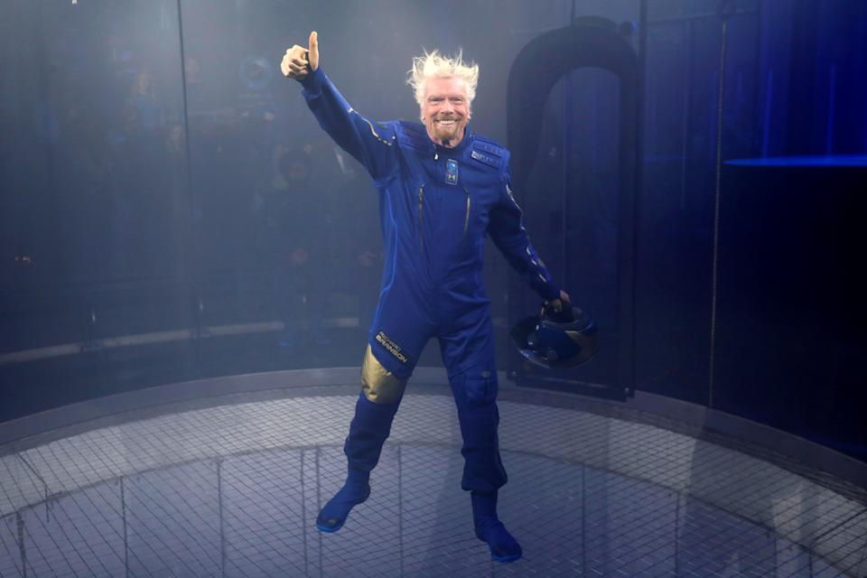Sir Richard Branson appears in a sky diving simulator as he wears Virgin Galactic's new space-wear system, developed in partnership with Under Armour, during an event to unveil the suits to be worn by future Virgin Galactic space travelers in Yonkers, New York, U.S., October 16, 2019. REUTERS/Mike Segar