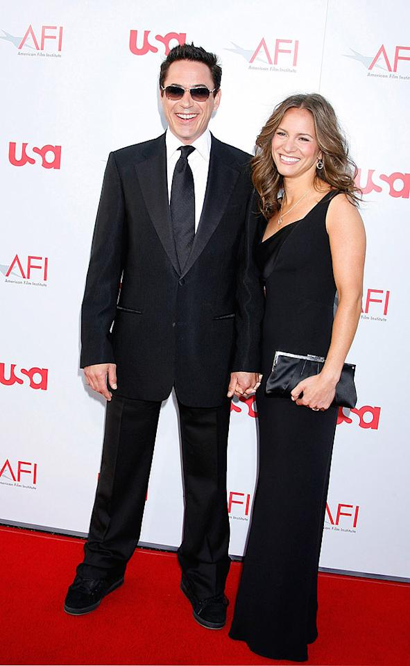 """Iron Man"" star Robert Downey Jr. and his wife Susan are all smiles as they make their way down the red carpet. Jeffrey Mayer/<a href=""http://www.wireimage.com"" target=""new"">WireImage.com</a> - June 12, 2008"
