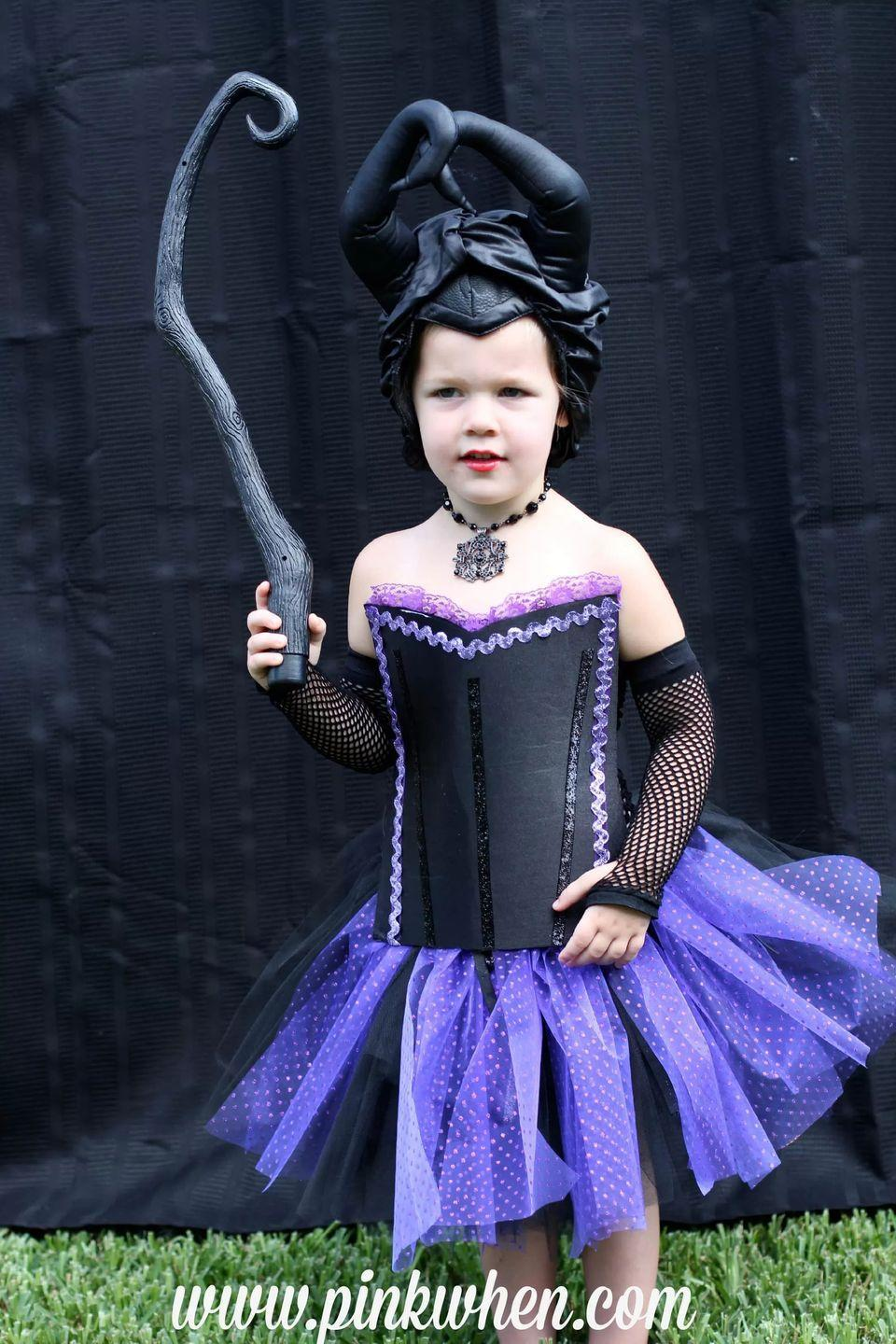 """<p>Thanks to clever use of a crochet band and Stitch Witch, this adorbs Maleficent costume is completely doable even for moms who don't like to sew. </p><p><strong>Get the tutorial at <a href=""""https://www.pinkwhen.com/diy-no-sew-maleficent-costume/"""" rel=""""nofollow noopener"""" target=""""_blank"""" data-ylk=""""slk:Pink When"""" class=""""link rapid-noclick-resp"""">Pink When</a>. </strong></p><p><a class=""""link rapid-noclick-resp"""" href=""""https://www.amazon.com/s?k=black+ribbon&ref=nb_sb_noss_1&tag=syn-yahoo-20&ascsubtag=%5Bartid%7C10050.g.36674692%5Bsrc%7Cyahoo-us"""" rel=""""nofollow noopener"""" target=""""_blank"""" data-ylk=""""slk:SHOP BLACK RIBBON"""">SHOP BLACK RIBBON</a><br></p>"""