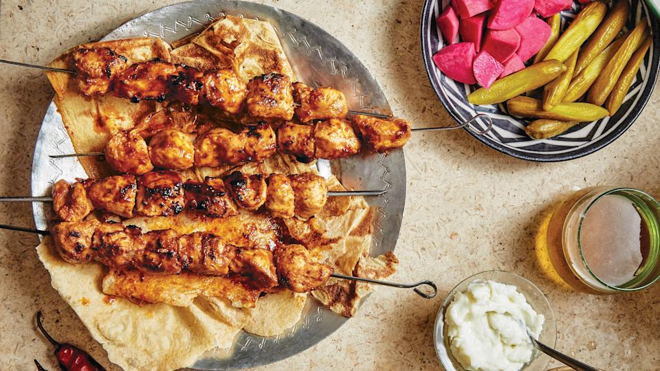 "Toum, an intense garlic sauce usually paired with shawarma, is used as both a marinade and a condiment in this chicken dish. <a href=""https://www.bonappetit.com/recipe/grilled-chicken-skewers-with-toum-shish-taouk?mbid=synd_yahoo_rss"" rel=""nofollow noopener"" target=""_blank"" data-ylk=""slk:See recipe."" class=""link rapid-noclick-resp"">See recipe.</a>"