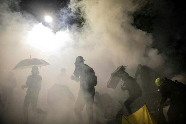 Police fired tear gas after night fell (AFP Photo/DALE DE LA REY)