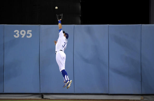 Los Angeles Dodgers center fielder Chris Taylor makes a catch on a ball hit by Toronto Blue Jays' Brandon Drury during the fourth inning of a baseball game Wednesday, Aug. 21, 2019, in Los Angeles. (AP Photo/Mark J. Terrill)