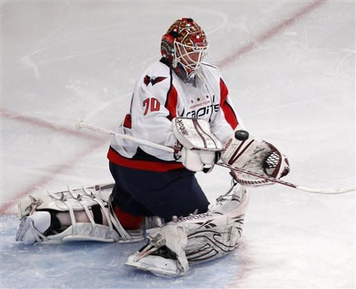Washington Capitals goalie Braden Holtby (70) makes a save in the second period of Game 2 of the NHL Eastern Conference semifinals at Madison Square Garden in New York, Monday, April 30, 2012. (AP Photo/Kathy Willens)