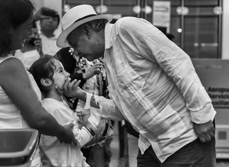 López Obrador welcomes a young girl in a departure lounge at Campeche airport after a campaign rally on June 26th. He made three final stopovers on the Yucatán Peninsula before returning to Mexico City.