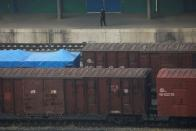Freight cars with Korean characters are seen at a train station in Dandong