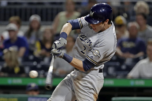 Milwaukee Brewers' Christian Yelich hits a solo home run off Pittsburgh Pirates relief pitcher Geoff Hartlieb during the ninth inning of a baseball game in Pittsburgh, Monday, Aug. 5, 2019. (AP Photo/Gene J. Puskar)