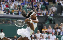 Coco Gauff of the US plays a return to Slovenia's Kaja Juvan during the women's singles third round match on day six of the Wimbledon Tennis Championships in London, Saturday July 3, 2021. (AP Photo/Alastair Grant)