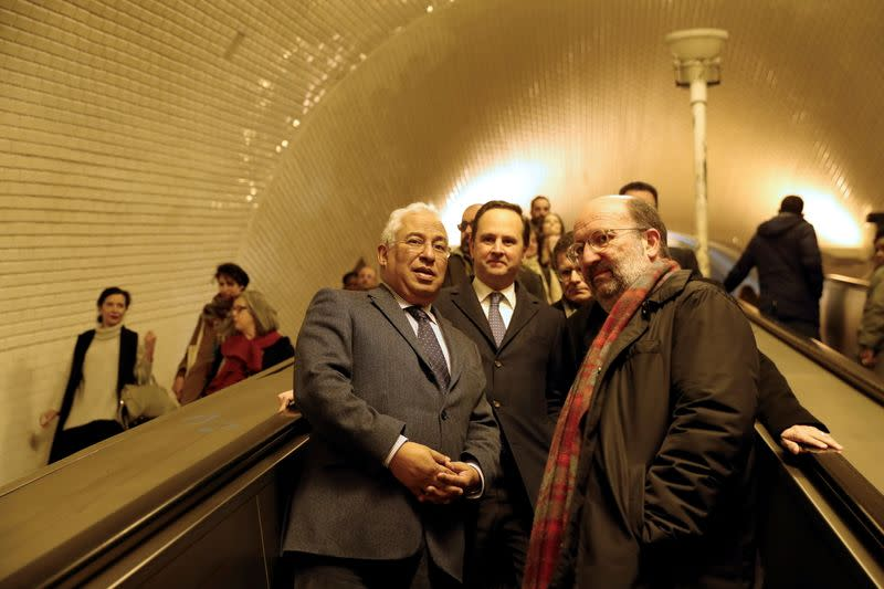 FILE PHOTO: Portugal's Prime Minister Antonio Costa, Minister of Environment Joao Pedro Matos and Lisbon's Mayor Fernando Medina ride an escalator at a subway station, during their visit to the Lisbon Metro in Lisbon