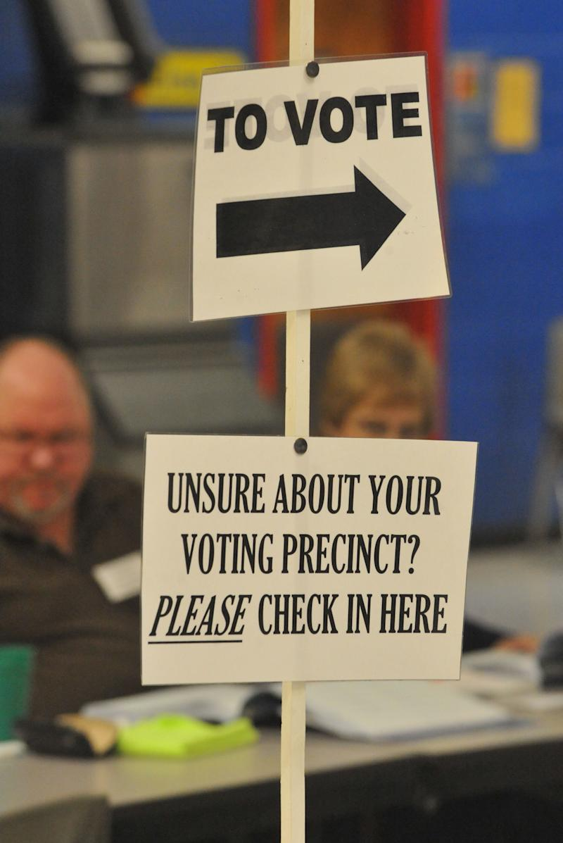 Signs are posted to help voters at the Suder Elementary School voting precinct in Jonesboro, Ga. on Election Day, Tuesday, Nov. 6, 2012. (AP Photo/Atlanta Journal-Constitution, Kent D. Johnson)  MARIETTA DAILY OUT; GWINNETT DAILY POST OUT; LOCAL TV OUT; WXIA-TV OUT; WGCL-TV OUT
