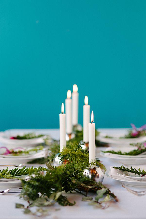 "<p>You know what silver bells mean-it's Christmas time! Dress up your table in holiday style with shiny candlestick holders that resemble baubles and bells.</p><p><strong>Get the tutorial at <a rel=""nofollow"" href=""https://apracticalwedding.com/non-floral-garland-centerpieces/"">A Practical Wedding</a>.</strong></p><p><strong><a rel=""nofollow"" href=""https://www.amazon.com/Krylon-K09196000-COVERMAXX-Metallic-Silver/dp/B013LT6JS8/"">SHOP SILVER SPRAY PAINT</a><br></strong></p>"