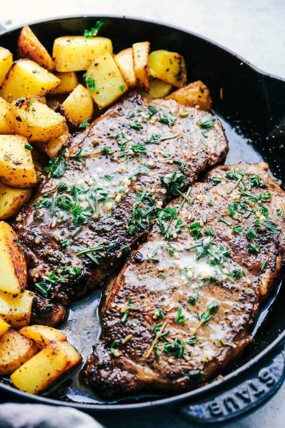 """<p>Pan-sear these garlicky cuts, then top them with a seriously delicious butter sauce. The blogger behind the recipes swears it's the best steak she's ever had.</p><p><strong>Get the recipe at <a href=""""https://therecipecritic.com/skillet-garlic-butter-herb-steak-and-potatoes/"""" rel=""""nofollow noopener"""" target=""""_blank"""" data-ylk=""""slk:The Recipe Critic"""" class=""""link rapid-noclick-resp"""">The Recipe Critic</a>.</strong></p><p><a class=""""link rapid-noclick-resp"""" href=""""https://go.redirectingat.com?id=74968X1596630&url=https%3A%2F%2Fwww.walmart.com%2Fbrowse%2Fhome%2Ffood-storage-containers%2Fthe-pioneer-woman%2F4044_623679_1032619_5842891%2FYnJhbmQ6VGhlIFBpb25lZXIgV29tYW4ie&sref=https%3A%2F%2Fwww.thepioneerwoman.com%2Ffood-cooking%2Fmeals-menus%2Fg35191871%2Fsteak-dinner-recipes%2F"""" rel=""""nofollow noopener"""" target=""""_blank"""" data-ylk=""""slk:SHOP FOOD STORAGE"""">SHOP FOOD STORAGE</a></p>"""