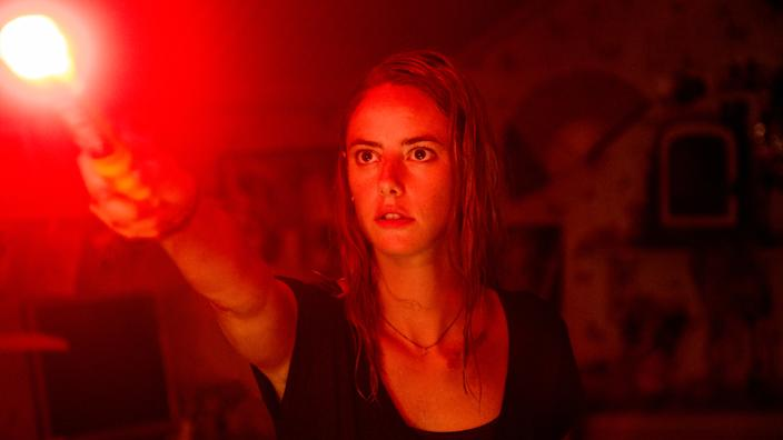 Kaya Scodelario defends her father and dog from rampaging alligators in horror movie 'Crawl'. (Credit: Paramount)