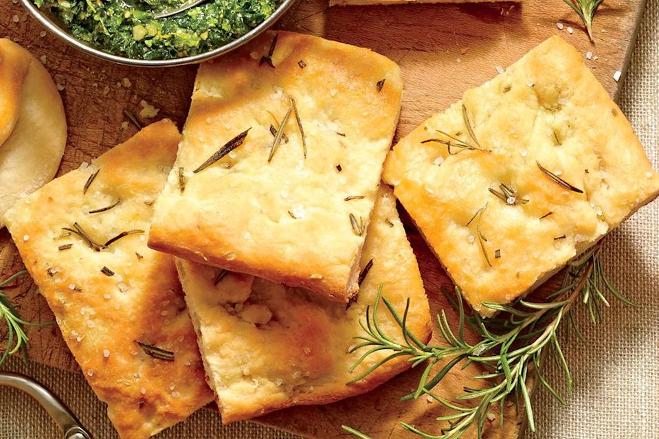 """<p><strong>Recipe</strong>: <a href=""""http://www.myrecipes.com/recipe/rosemary-focaccia-bread-50400000131327/"""" rel=""""nofollow noopener"""" target=""""_blank"""" data-ylk=""""slk:Rosemary Focaccia Bread"""" class=""""link rapid-noclick-resp""""><strong>Rosemary Focaccia Bread</strong></a></p> <p>Pair this flavorful herb bread with <a href=""""http://www.myrecipes.com/recipe/turnip-green-pesto-50400000131329/"""" rel=""""nofollow noopener"""" target=""""_blank"""" data-ylk=""""slk:Turnip Green Pesto"""" class=""""link rapid-noclick-resp"""">Turnip Green Pesto</a> for a mouth-watering appetizer.</p>"""