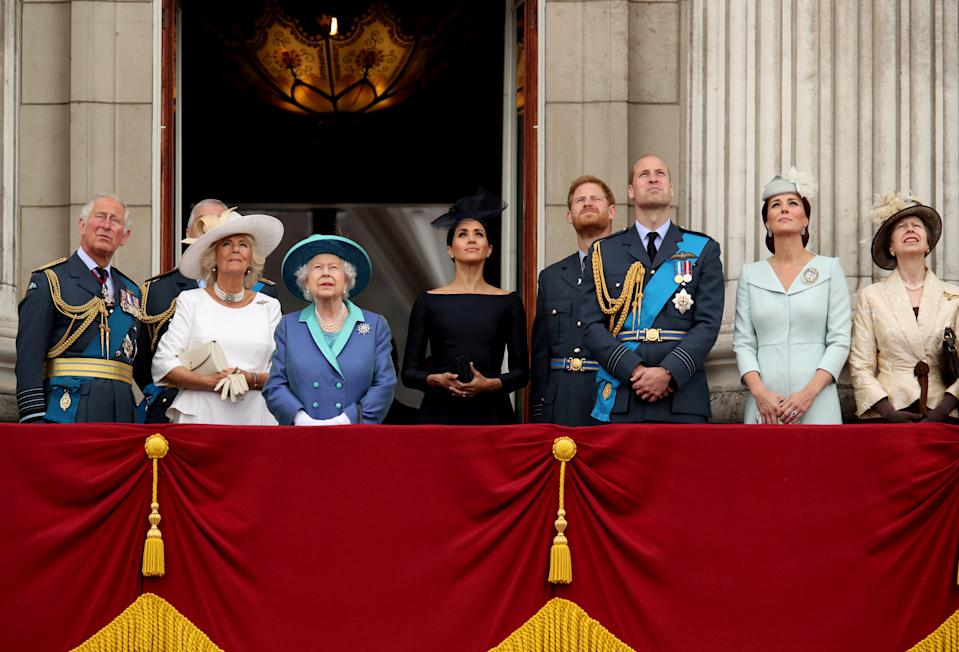Britain's Prince Charles, Camilla, Duchess of Cornwall, Queen Elizabeth, Meghan, Duchess of Sussex, Prince Harry, Prince William, Catherine, Duchess of Cambridge and Princess Anne stand on the balcony of Buckingham Palace as they watch a fly past to mark the centenary of the Royal Air Force in central London, Britain July 10, 2018. REUTERS/Chris Radburn     TPX IMAGES OF THE DAY