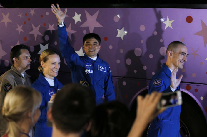 <p>U.S. astronaut Kate Rubins, 2nd left, Russian cosmonaut Anatoly Ivanishin, right, and Japanese astronaut Takuya Onishi, members of the main crew to the International Space Station (ISS), wave as they walk to a bus from a hotel prior to the launch of the Soyuz-FG rocket at the Russian leased Baikonur cosmodrome, in Kazakhstan, Thursday, July 7, 2016. (AP Photo/Dmitri Lovetsky) </p>
