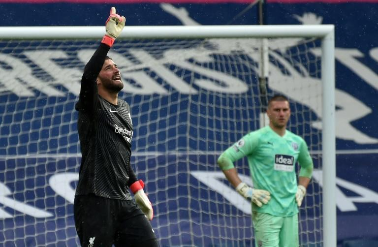 Liverpool goalkeeper Alisson Becker (left)dedicated his winning goal over West Brom to his late father
