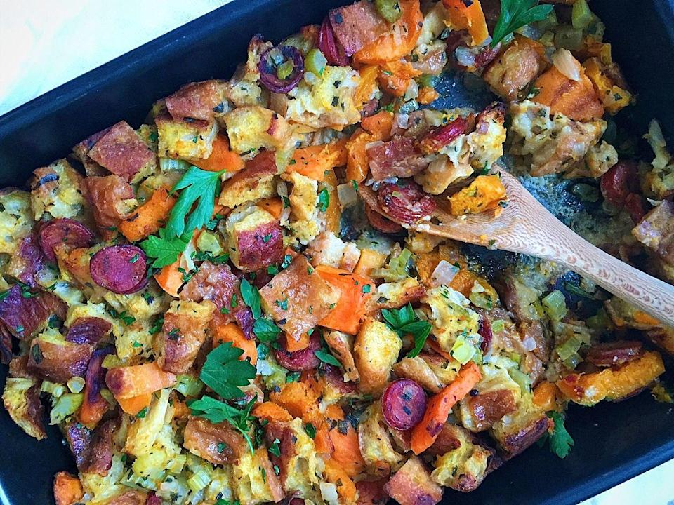 """<p>This stuffing gets a sweet side and spicy kick from andouille sausage and butternut squash.</p><p>Get the recipe from <a href=""""https://www.delish.com/cooking/recipe-ideas/recipes/a44615/butternut-squash-andouille-stuffing-recipe/"""" rel=""""nofollow noopener"""" target=""""_blank"""" data-ylk=""""slk:Delish"""" class=""""link rapid-noclick-resp"""">Delish</a>.</p>"""