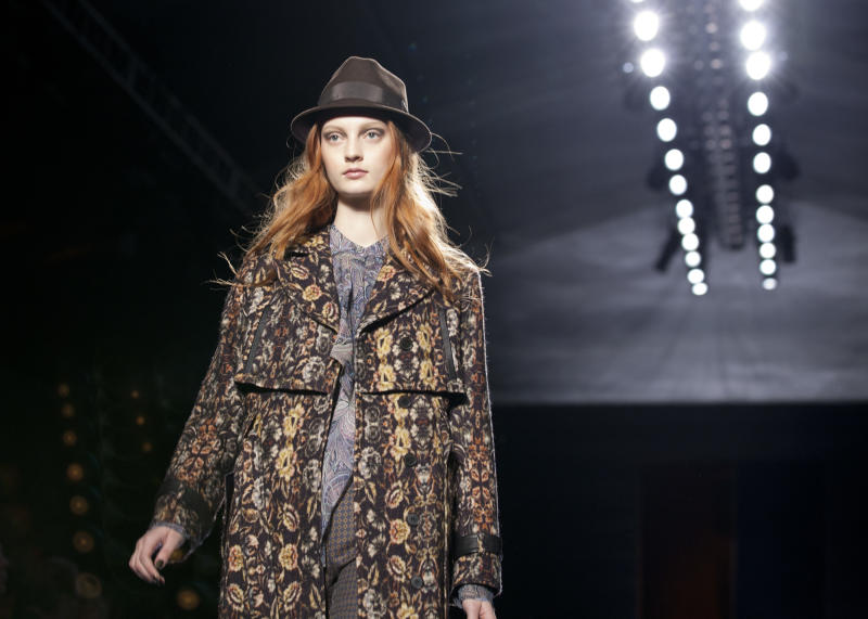 A model walks the runway during the Nicole Miller Fall 2013 fashion show during Fashion Week, Friday, Feb. 8, 2013, in New York. (AP Photo/Karly Domb Sadof)