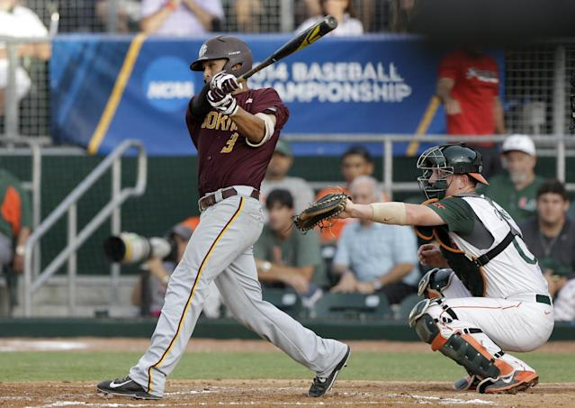 Bethune-Cookman's Shaun McCarty (3) follows through on a base hit against Miami during the second inning of an NCAA college baseball regional tournament game in Coral Gables, Fla., Friday, May 30, 2014. (AP Photo/Alan Diaz)