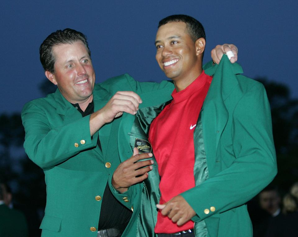 <p>Tiger Woods, right, gets the Green Jacket from Phil Mickelson, left, after winning the 2005 Masters at the Augusta National Golf Club in Augusta, Ga., Sunday, April 10, 2005. This is Woods' foruth Masters victory. (AP Photo/Morry Gash) </p>