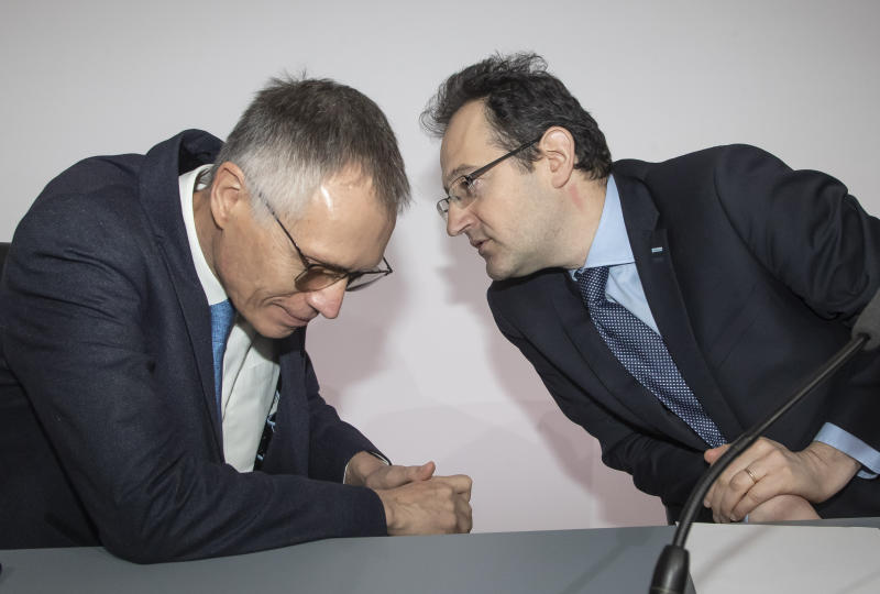 CEO of PSA Groupe Carlos Tavares, left, confers with CFO Philippe de Rovira during the presentation of the company's 2019 full year results, in Rueil-Malmaison, west of Paris, Wednesday, Feb. 26, 2020. The French carmaker announced a new profitability record in 2019. (AP Photo/Michel Euler)