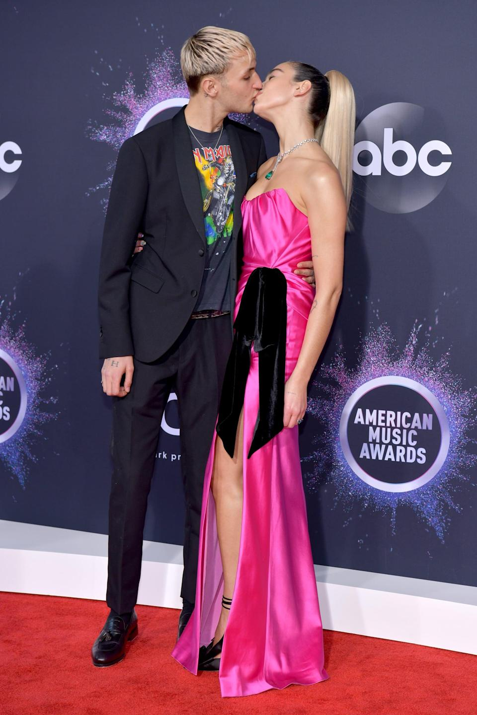"""<p>Now tell me this doesn't make your heart soar? We love that Anwar kept it casual by pairing his suit with a t-shirt, and Dua <a href=""""https://www.popsugar.com/fashion/dua-lipa-pink-dress-at-amas-2019-46941510"""" class=""""link rapid-noclick-resp"""" rel=""""nofollow noopener"""" target=""""_blank"""" data-ylk=""""slk:opted for a pink gown with a giant bow"""">opted for a pink gown with a giant bow</a>.</p>"""