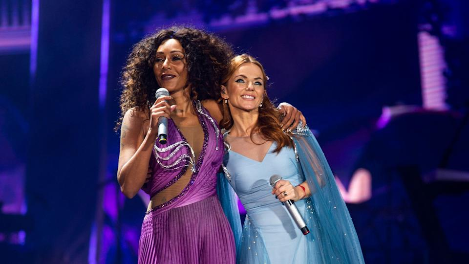 Mel B and Geri Horner embrace on stage at the opening night of the Spice Girls Spice World 2019 reunion tour in Dublin (Credit: Andrew Timms/PA)