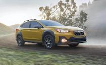 """<p>The <a href=""""https://www.caranddriver.com/subaru/crosstrek"""" rel=""""nofollow noopener"""" target=""""_blank"""" data-ylk=""""slk:Subaru Crosstrek"""" class=""""link rapid-noclick-resp"""">Subaru Crosstrek</a> caters to the adventurous with a durable interior, standard all-wheel drive, nearly nine inches of ground clearance, and space inside for a team of Laberdoodles. It's also one of only five <a href=""""https://www.caranddriver.com/features/g15379070/manual-transmission-suv/"""" rel=""""nofollow noopener"""" target=""""_blank"""" data-ylk=""""slk:crossovers and SUVs still sold with a manual transmission"""" class=""""link rapid-noclick-resp"""">crossovers and SUVs still sold with a manual transmission</a>. We put 19 carry-on suitcases in the Crosstrek despite its 60/40 split-folding rear seats being unable to create a completely flat load floor. The Crosstrek Hybrid has a slightly higher cargo floor to accommodate its battery pack, but we were still able to fit 17 carry-ons for that model. </p><ul><li>Base price: $23,295</li><li>Carry-on capacity, rear seats folded: 19 suitcases</li><li>Cargo volume, rear seats folded: 55 cubic feet<br></li><li>Cargo volume, behind rearmost row of seats: 20 cubic feet<br></li></ul><p><a class=""""link rapid-noclick-resp"""" href=""""https://www.caranddriver.com/subaru/crosstrek/specs"""" rel=""""nofollow noopener"""" target=""""_blank"""" data-ylk=""""slk:MORE CROSSTREK SPECS"""">MORE CROSSTREK SPECS</a></p>"""