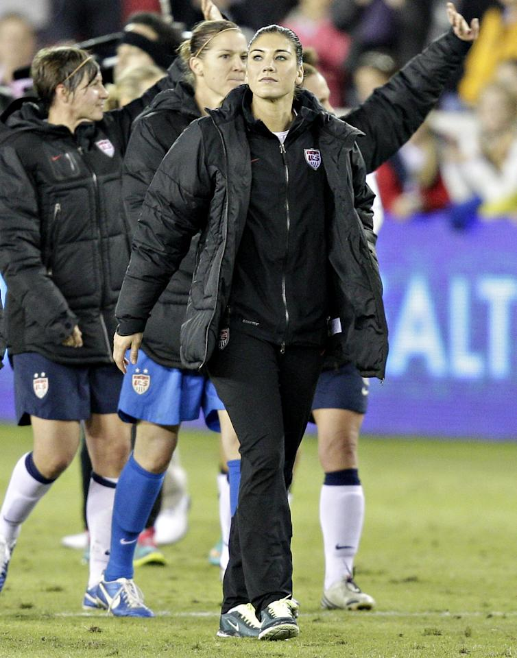 HOUSTON, TX - DECEMBER 12: Hope Solo (1) of the United States walks off the  field after defeating China at BBVA Compass Stadium on December 12, 2012 in Houston, Texas. USA won 4-0. (Photo by Bob Levey/Getty Images)