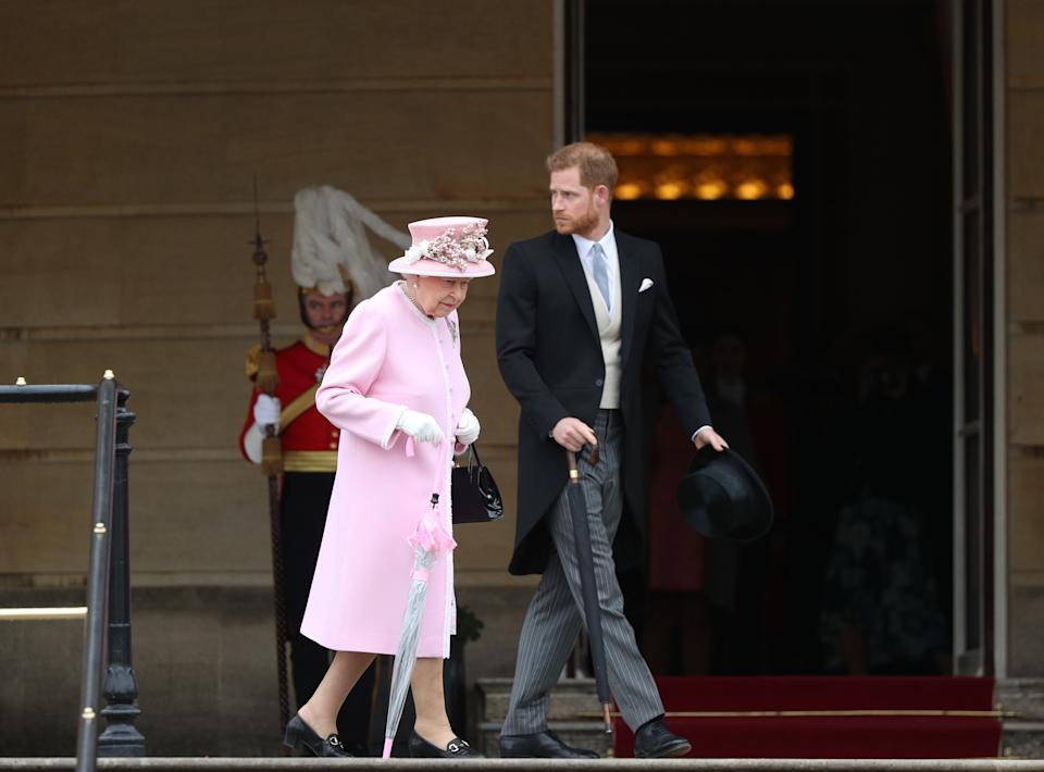 LONDON, ENGLAND - MAY 29: Queen Elizabeth II and Prince Harry, Duke of Sussex attend the Royal Garden Party at Buckingham Palace on May 29, 2019 in London, England. (Photo by Yui Mok - WPA Pool/Getty Images)