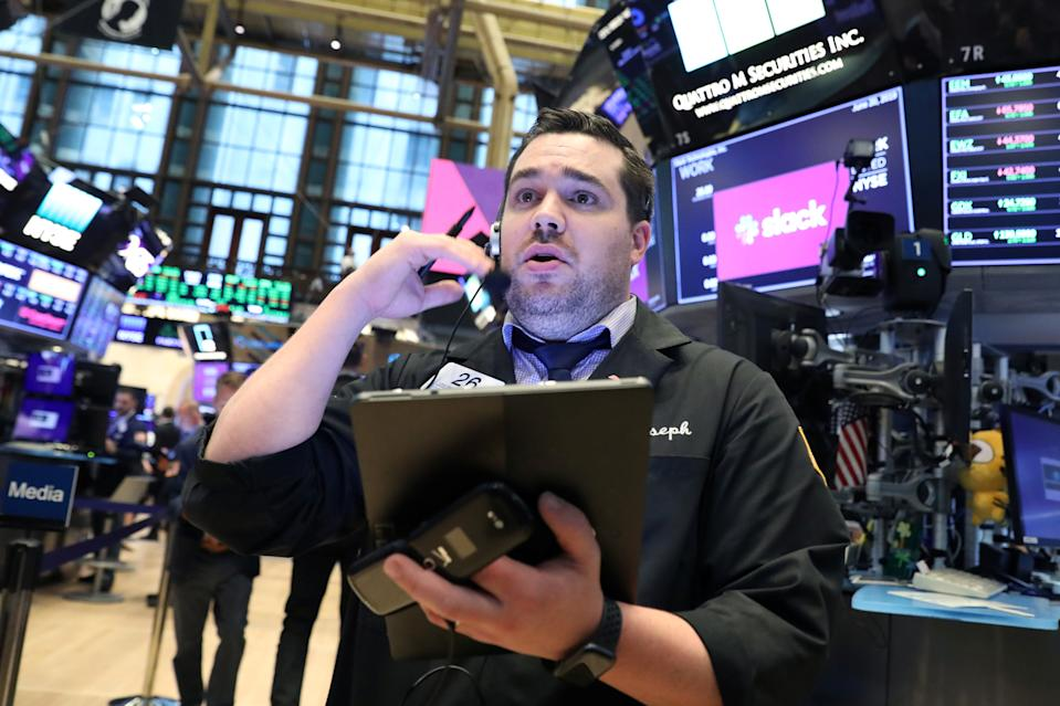 A trader works on the floor during the Slack Technologies Inc. IPO at the New York Stock Exchange (NYSE) in New York, U.S. June 20, 2019.  REUTERS/Brendan McDermid