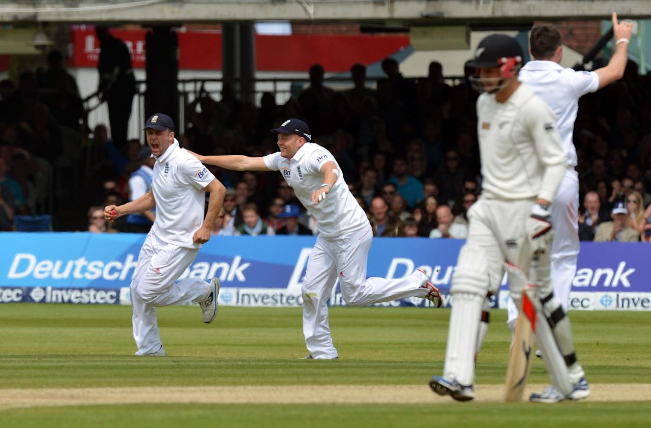 England's Jonathan Trott (left) is congratulated by Johnny Bairstow after catching New Zealand's Bradley-John Watling for 13 during the first test at Lord's Cricket Ground, London.