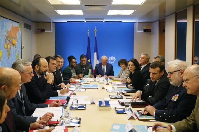 French President Emmanuel Macron, third right, chairs a meeting concerning Covid-19