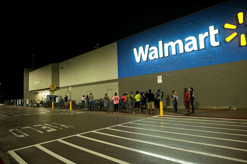 People wait in line early Thursday morning for a Beaumont, Texas, Walmart to open. (Joseph Rushmore for HuffPost)