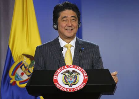 Japan's Prime Minister Shinzo Abe smiles during a news conference at the presidential palace in Bogota July 29, 2014. Abe is on a one-day official visit to Bogota. REUTERS/John Vizcaino