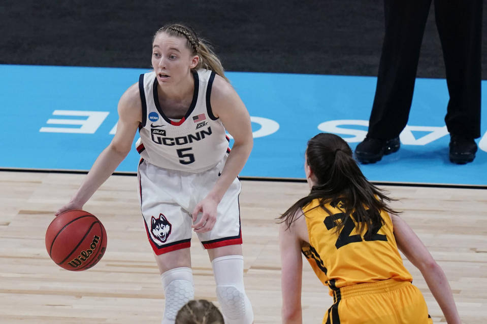 UConn guard Paige Bueckers (5) works the ball past Iowa guard Caitlin Clark (22) during the first half of a college basketball game in the Sweet Sixteen round of the women's NCAA tournament at the Alamodome in San Antonio, Saturday, March 27, 2021. (AP Photo/Eric Gay)