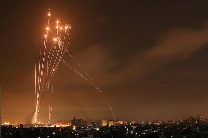 Rockets light up the night sky above Beit Lahia in the northern Gaza Strip.