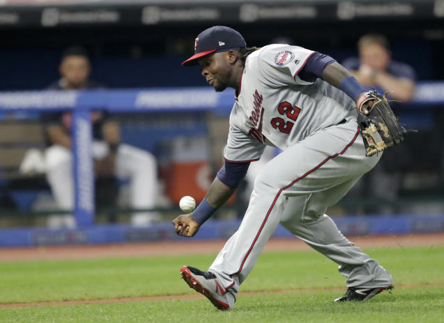 Minnesota Twins' Miguel Sano can't get to a bunt by Cleveland Indians' Brandon Guyer during the fifth inning of a baseball game, Wednesday, Aug. 8, 2018, in Cleveland. Guyer was safe at first base for a single. (AP Photo/Tony Dejak)
