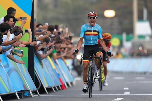 Belgium's Greg Van Avermaet celebrates after winning the men's road cycling race in Rio de Janeiro on August 6, 2016 (AFP Photo/Adrian Dennis)