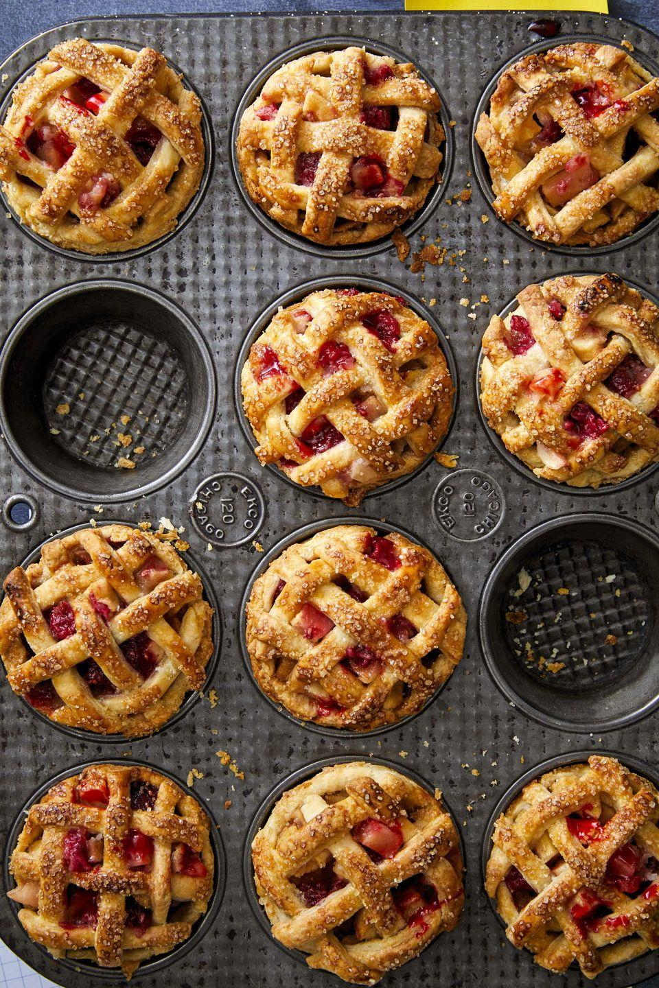 """<p>Treat guests to the perfect bite-size after-dinner treat with these gorgeous little single-serving pies.</p><p><strong><a href=""""https://www.countryliving.com/food-drinks/a33553885/mini-apple-and-raspberry-pies/"""" rel=""""nofollow noopener"""" target=""""_blank"""" data-ylk=""""slk:Get the recipe"""" class=""""link rapid-noclick-resp"""">Get the recipe</a>.</strong> </p>"""