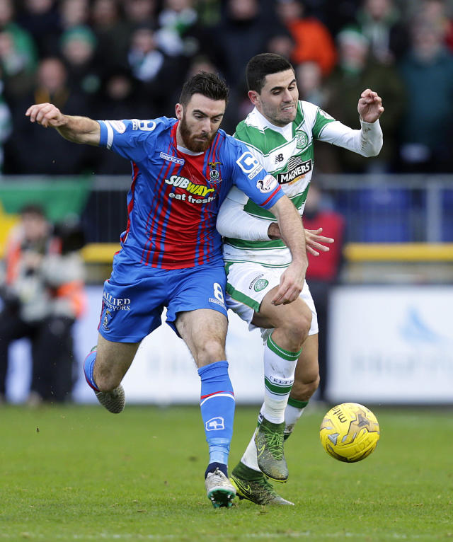 "Football Soccer - Inverness Caledonian Thistle v Celtic - Ladbrokes Scottish Premiership - Tulloch Caledonian Stadium - 29/11/15 Inverness Caledonian Thistle's Ross Draper (L) in action with Celtic's Tom Rogic Action Images via Reuters / Graham Stuart Livepic EDITORIAL USE ONLY. No use with unauthorized audio, video, data, fixture lists, club/league logos or ""live"" services. Online in-match use limited to 45 images, no video emulation. No use in betting, games or single club/league/player publications. Please contact your account representative for further details."