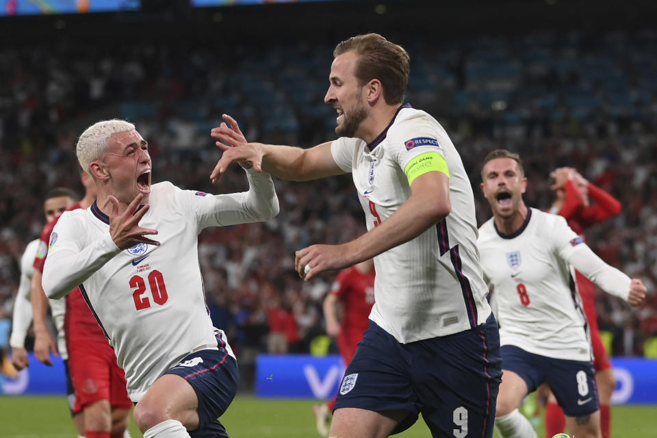 FILE - In this July 7, 2021 file photo England's Harry Kane, right, celebrates scoring his side's second goal during the Euro 2020 soccer semifinal match between England and Denmark at Wembley stadium in London. (Laurence Griffiths/Pool Photo via AP, File)